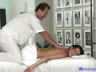 First time when this brunette gets laid with the addition of enjoys creampie during massage